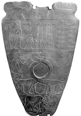 Bull Palette - Narmer Palette, front, with Bull defeating warrior in lower register; fortifications on right.