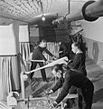 National Fire Service on War Production- War work in a Fire Station, London, England, UK, 1943 D17210.jpg