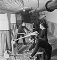 National Fire Service on War Production- War work in a Fire Station, London, England, UK, 1943 D17210.jpg