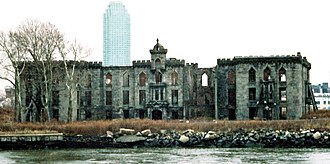 Smallpox Hospital - The hospital seen from the west in the East River, with the Citicorp Building in Queens in the background (1996)