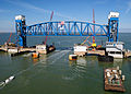 New lift span being installed on Galveston Causeway rail line, before removal of old bascule bridge abutments, Feb. 2012.jpg