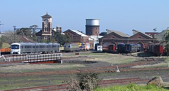 Newport Workshops - Overview of the 'West Block' section of the workshops, with the clocktower and admin block to the left and Steamrail Victoria depot to the right in August 2005