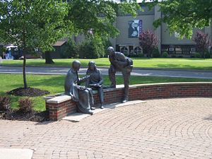 Niagara University - A statue of St. Vincent de Paul talking to students, which is common to all Vincentian universities in the United States.