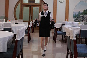Waiting staff - A waitress in the Samjiyon Pegaebong hotel, North Korea