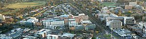 Parkville, Victoria - Aerial of Parkville looking north.  Visible is Royal Park (top left); Royal Melbourne Hospital (centre left); Royal Parade (centre) and University of Melbourne campus (right).