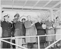 Photograph of President Truman and other dignitaries on the reviewing stand, saluting during the Army Day parade. - NARA - 200106.tif