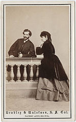 Photograph of a man and a woman leaning on a balustrade.jpg