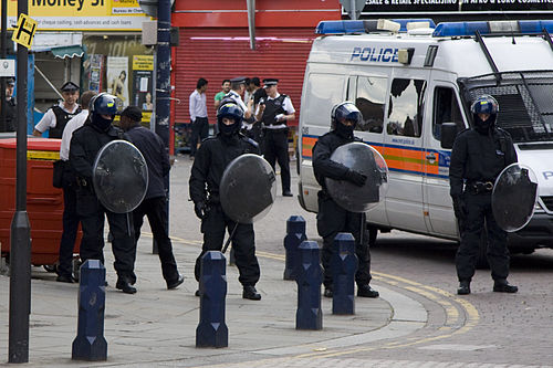 Police with riot shields in Lewisham, 2011
