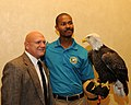 Posing for picture with Bald Eagle. (10594950745).jpg