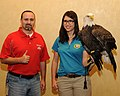 Posing for picture with Bald Eagle. (10596925475).jpg