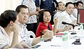 President Gloria Macapagal-Arroyo gestures as she presides over the National Disaster Coordinating Council Meeting.jpg