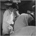 Pvt. J.B. Slagle, USA, receives his daily dressing of wounds on board USS Solace (AH-5) enroute from Okinawa to Guam. - NARA - 520747.tif