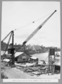 Queensland State Archives 3303 Construction of sand and gravel hoppers at north main pier 2 April 1936.png
