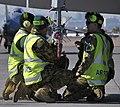 RAAF ground crew fitting a training bomb to an FA-18 2010.JPG