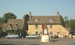 Ramsden, Oxfordshire - Akeman cottage (left), the Royal Oak public house (right) and parish war memorial (foreground)