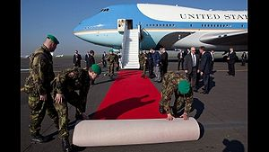 Deploying of red carpet from Air Force One.