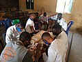 Repackaging medicines at a community medical outreach.jpg