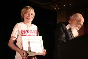 Rhys Morgan - Rhys Morgan receiving the James Randi Award for Grassroots Activism (TAM London, 16 October 2010. Photo by Kelly Haddow). On the right is James Randi.