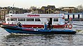 Rigid-hulled inflatable speedboat and City Cruises 'MV Westminster' on the River Thames, London.jpg