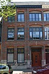Herenhuis tezamen met Brugstraat 25 als een dubbel huis gebouwd