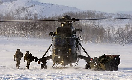 A Royal Navy Westland Sea King HC4 of the Commando Helicopter Force, seen in Norway during Arctic flying training in 2012. Royal Navy Sea King Mk4 HelicopterConducting Arctic Training in Norway MOD 45153643.jpg