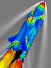 SSLV at Mach 2.46 and 66,000 feet (20,000 m). The surface of the vehicle is colored by the pressure coefficient, and the gray contours represent the density of the surrounding air, as calculated using the OVERFLOW codes.