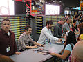 San Diego Comic-Con 2011 - Elijah Wood and Jason Gann from Wilfred sign for fans (Fox booth) (5977356376).jpg