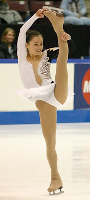Sasha Cohen - Sasha Cohen performs an I-spin at the 2003 Skate Canada competition in Mississauga, Ontario, Canada.