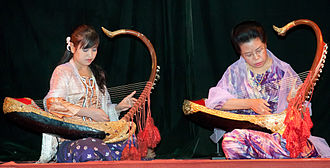 Music of Myanmar - Two female musicians play the saung at a performance in Mandalay.