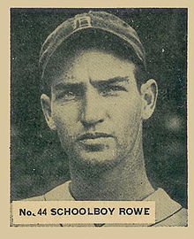 "A baseball card image of a man wearing a dark baseball cap with an Old English ""D"" on the face"