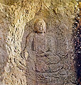 Seated Buddha Carved on the Rock at Donghwasa temple in Daegu, Korea.jpg