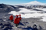 Secretary Kerry Walks Against a Backdrop of Mount Erebus and the hut in Cape Royds, Antarctica (30913575945).jpg