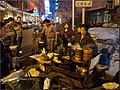 Shanghai - side street of Nanjing Road (6275637431).jpg