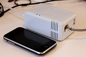 Sheevaplug plug computer with iPhone for scale