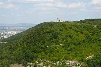 """Shumen Plateau Nature Park - """"Creators of the Bulgarian State"""" monument on the top of a hill in the park"""