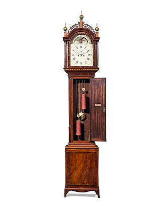 "Simon Willard clocks - Simon Willard Roxbury Tall Case Clock. Circa 1793. A brass plaque reads ""Given by John Goddard as a wedding gift to his son Benjamin Goddard, M. Louisa May, 1793."" Dial signed ""Simon Willard."""
