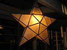 a simple star shaped parol made of capiz shells - Filipino Christmas Star