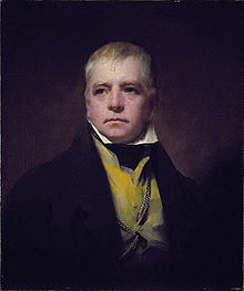 Half-length portrait of a man in a black suit with a mustard vest and wispy blonde hair.