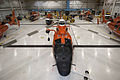Six U.S. Coast Guard MH-65 Dolphin helicopters from Coast Guard Air Stations Mobile, Ala., New Orleans and Houston are stored inside a hangar at Air Station Houston Aug. 28, 2012, in preparation for Hurricane 120828-G-EK967-124.jpg
