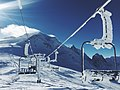 Snow covered ski lift (Unsplash).jpg
