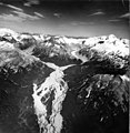 Snowy Mountain and Mount Denison, terminus and trim line of valley glacier in the background, and outwash plain with braided (GLACIERS 7046).jpg