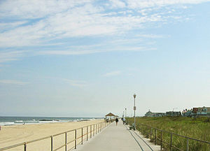 Spring Lake, New Jersey - A view of the Spring Lake beach, boardwalk, dunes, and oceanfront homes