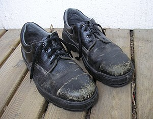 Steel-toe boot - A pair of well-worn steel-toe shoes