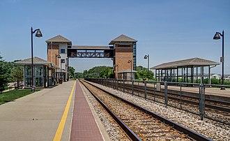 Sturtevant station - The platforms, tracks and pedestrian bridge at Sturtevant station.