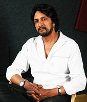Sudeep looking at the camera