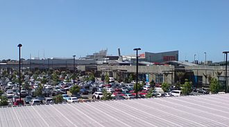 Sylvia Park - A view over the main carpark and length of the centre, with the cinemas and railway station at the right rear.