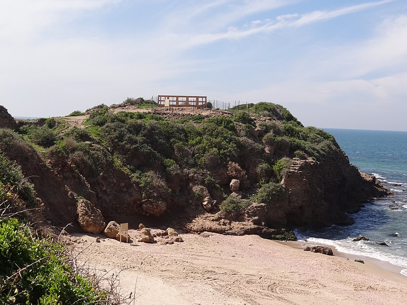 a structure above a rocky cliff