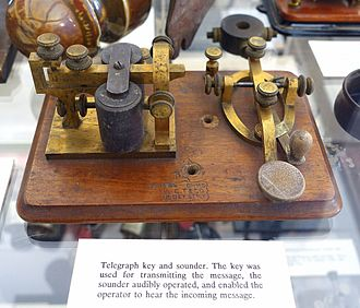 "Telegraph key and sounder. The signal is ""on"" when the knob is pressed, and ""off"" when it is released. Length and timing of the dots and dashes are entirely controlled by the telegraphist. Telegraph key and sounder, L.C.T. (L. C. Tillotson) and Co., 8 Dey Street, NY - Bennington Museum - Bennington, VT - DSC08636.JPG"