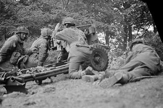 Border Regiment - A 6-pdr anti-tank gun of No. 26 Anti-Tank Platoon, 1st Battalion, Border Regiment, during the Battle of Arnhem, 20 September 1944. The gun was at this moment engaging a German PzKpfw B2 (f) tank, and successfully knocked it out.