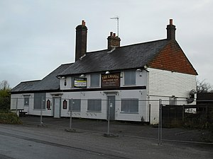 Pease Pottage - The Grapes Inn pictured in 2009, just before its demolition
